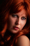 Red-hair woman. Red hair woman looking to left Royalty Free Stock Photos