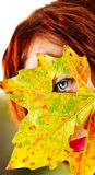 Red hair woman and autumn leaf Royalty Free Stock Photos