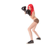 Red hair woman is boxing over white Royalty Free Stock Photos
