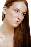 Red hair woman with drops on her face. Close up Royalty Free Stock Photos