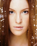 Red hair woman with drops on her face. Sad at windows, rain outside Stock Photography