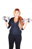 Red hair woman with dumbbells. Royalty Free Stock Photo