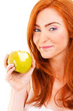 Red hair woman eat green apple on white Royalty Free Stock Photo