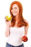 Red hair woman eat green apple on white Royalty Free Stock Images