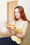 Red-hair woman eating fruits salad Stock Photo