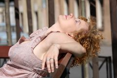Red hair woman enjoying sun Royalty Free Stock Images