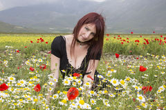 Red hair woman on flowers Royalty Free Stock Image