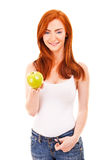 Red hair woman with green apple on white Stock Photos