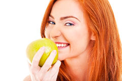 Red hair woman with green apple Royalty Free Stock Photo