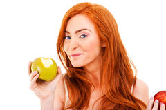 Red hair woman with green apple Royalty Free Stock Image
