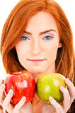 Red hair woman with green apple Stock Photo
