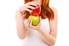 Red hair woman with green and red apple Stock Images