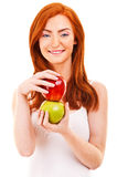 Red hair woman with green and red apple on white Royalty Free Stock Photos