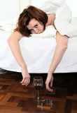 Red hair woman with hangover after drinking wine Stock Images