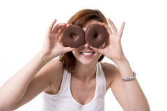 Red hair woman holding chocolate donuts as eyes Stock Image