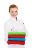 Red hair woman holding color towels. Stock Photography