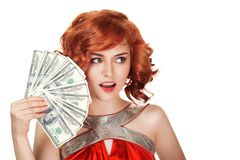 Red hair woman holding dollars in hand. royalty free stock photography