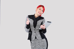 Red hair woman holding tablet Royalty Free Stock Photos