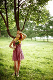 Red Hair Woman in Light Dress Stock Photo