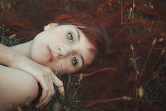 Red hair woman portrait. Red hair woman posing on grass. Simple autumn portrait Royalty Free Stock Image