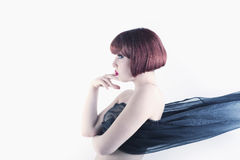 Red hair woman portrait side view Stock Image
