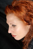 Red hair woman side-face Royalty Free Stock Photography