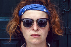 Red hair woman with sunglasses Royalty Free Stock Photo
