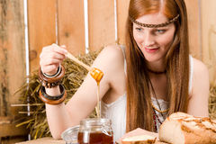 Red-hair young hippie woman breakfast in barn Stock Images