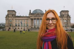 Red hair young woman near the Reichstag building german government in Berlin, Germany. Close up Royalty Free Stock Photo