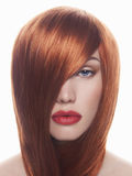 Red hair young woman with red lips Stock Image