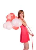 Red-haired девушка в розовом платье с воздушными шарами стоковое фото rf