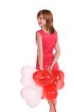 Red-haired девушка в розовом платье с воздушными шарами стоковые фотографии rf