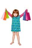 red-haired девушка с хозяйственными сумками стоковая фотография