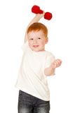 Red-haired adorable boy making exercise Stock Image