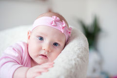 Red-haired baby with a beautiful bandage Stock Photo