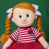 Red haired baby doll Royalty Free Stock Images