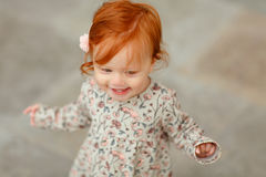 Red-haired baby girl close-up portrait.  Royalty Free Stock Images