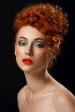 Red-haired. Beautiful girl with bright makeup Stock Photo