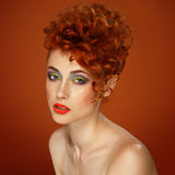 Red-haired. Beautiful girl with bright makeup Stock Images