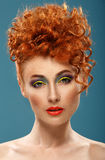Red-haired. Beautiful girl with colour bright makeup Stock Photo