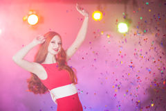 Red-haired beautiful girl in a nightclub dancing Royalty Free Stock Photography