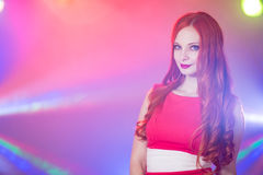 Red-haired beautiful girl in a nightclub dancing Stock Photography