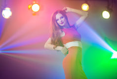 Red-haired beautiful girl in a nightclub dancing Royalty Free Stock Photo