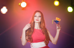 Red-haired beautiful girl in a nightclub dancing Stock Image