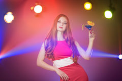 Red-haired beautiful girl in a nightclub dancing Stock Images