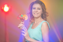 Red-haired beautiful girl in a nightclub dancing Royalty Free Stock Image