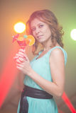 Red-haired beautiful girl in a nightclub dancing Stock Photo