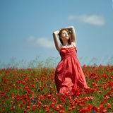 Red haired beautiful girl in poppy field Royalty Free Stock Images