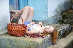 Red-haired beauty in a summer sarafan Royalty Free Stock Photo