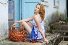 Red-haired beauty in a summer sarafan Royalty Free Stock Images